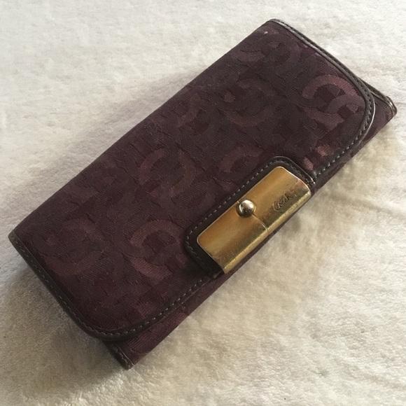 Purple Coach monogram leather & canvas wallet